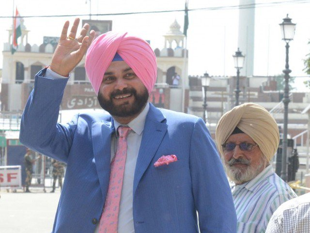 India's Former Cricket Star Sidhu Arrives In Pakistan To Attends Imran's Oath-Taking With 'Message Of Love'